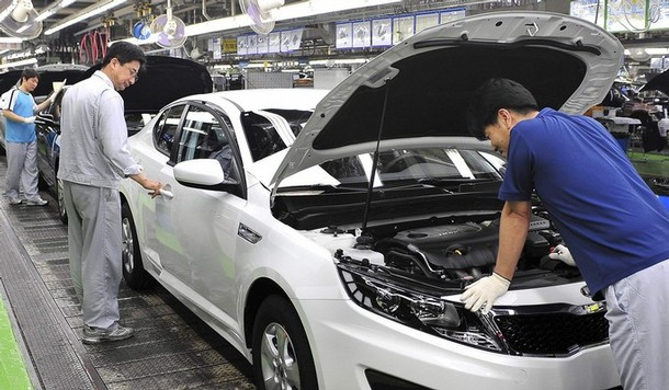 Workers are seen at Kia Motors K5 assembly line at Hwaseong plant Kia adding Optima to production line on Georgia plant.